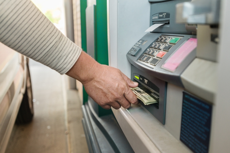 Person getting money from ATM
