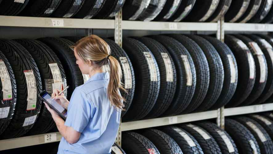 Woman taking inventory on tires